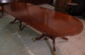 A George III style mahogany twin pillar dining table, on outswept supports, 306cm wide x 78cm high.