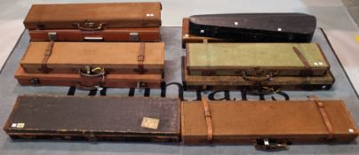 Ten various rectangular travelling shotgun cases and a wooden violin case, (11).