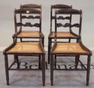 A set of four Victorian stained beech bar back dining chairs on turned supports,
