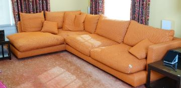 A contemporary Long Island sectional sofa, in three parts, upholstered in orange woven fabric,