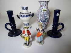 Continental ceramics to include; a pair of German porcelain figures, a Gien floral decorated vase,