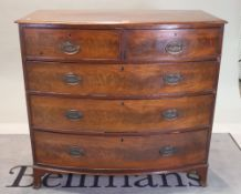 A George III mahogany bowfront chest of two short and three long graduated drawers,