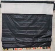 A Roman blind in dark blue with a colourful lower border, 125cm wide x 200cm long.