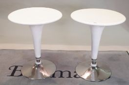 A pair of modern white lacquer circular occasional tables on chrome bases,