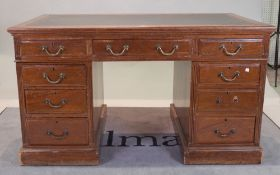 An early 20th century walnut pedestal desk,