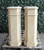 A pair of modern faux marble plaster columns, 34cm wide x 96cm high (a.f.), (2).
