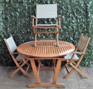 A modern hardwood circular extending garden table,