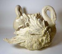 A similar pair of modern resin jardinieres formed as swans, each 58cm long x 48cm high.
