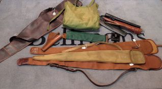Three canvas gun slips and one leather, together with a quantity of quivers and pistol holsters,