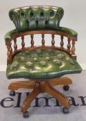 A modern stained beech office open armchair with green leather buttonback upholstery,