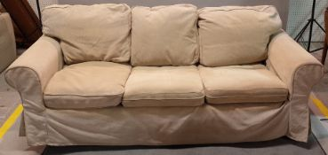 A modern hardwood framed three seater sofa on block supports, 215cm wide x 73cm high.
