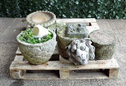 Garden statuary including a pair of early 20th century reconstituted stone wall hanging plaques,