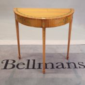 A George III style satinwood and painted 'D' shape console table on tapering square supports,