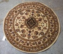 A round machine made rug, 133cm diameter.