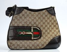 A Gucci canvas and brown leather shoulder bag