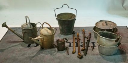 Two galvanised steel watering cans, a Braimes oil can, a bucket, various pots, irons and four...