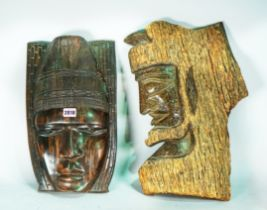 Two early 20th century carved hardwood tribal masks