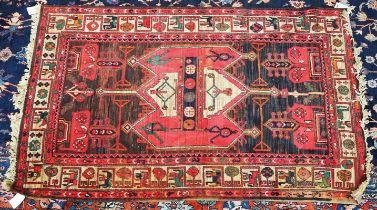 A machine made rug of Caucasian design