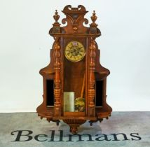 A 19th century walnut cased Vienna regulator wall clock, with glazed door flanked by small...