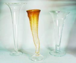 An amber glass cornucopia flower vase