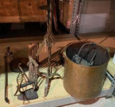 A pair of modern wrought iron candlesticks