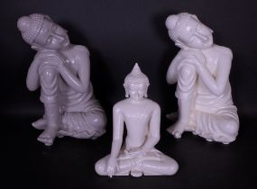 A pair of modern resin figures of Buddha and another similar