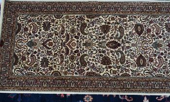 A machine made floral runner of Persian design