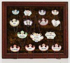 A COLLECTION OF ENAMEL WINE AND SPIRIT LABELS IN THREE GLAZED FRAMES (3)