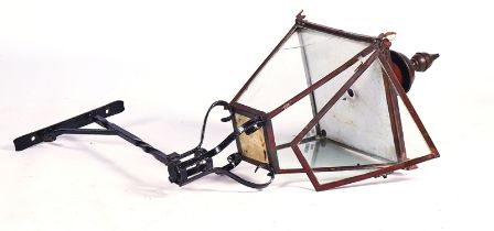 A VICTORIAN STYLE COPPER AND WROUGHT IRON STREET LANTERN