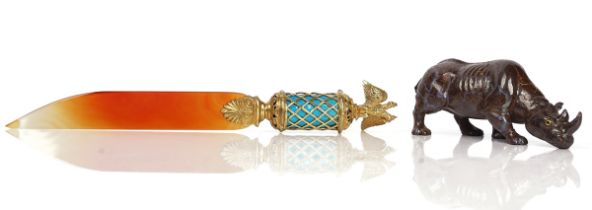 A CARVED BOULDER OPAL MODEL OF A RHINOCEROS AND A RUSSIAN STYLE AGATE LETTER OPENER (2)