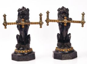 A PAIR OF VICTORIAN CAST IRON AND BRASS FIRE DOGS / TOOL RESTS