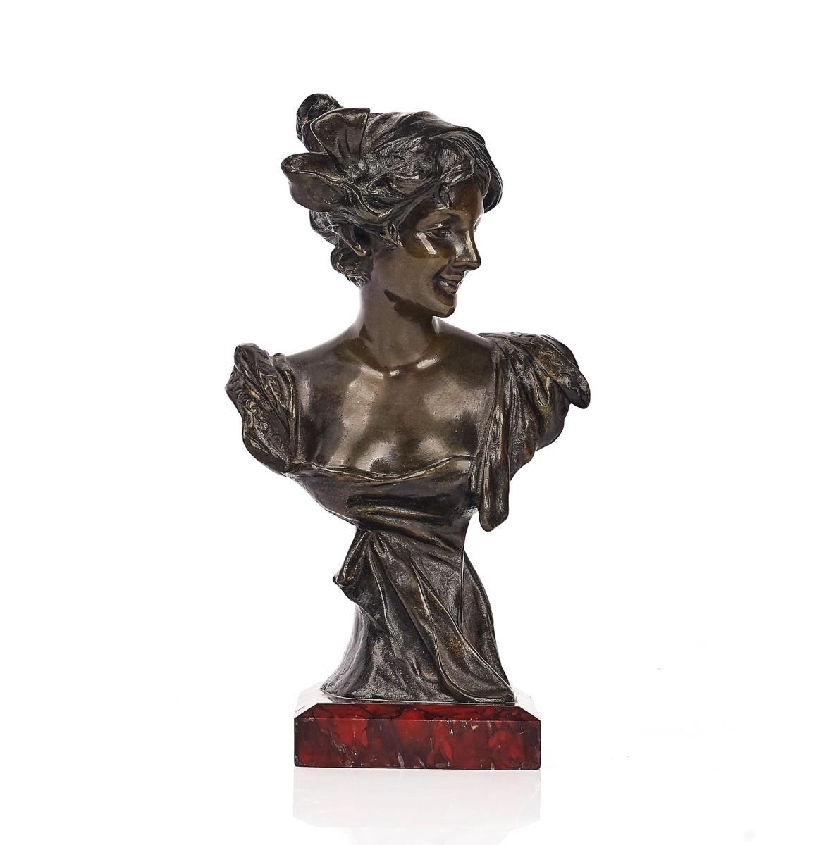A BRONZE BUST OF AN ART NOUVEAU LADY
