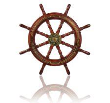 A BRASS-BOUND TEAK SHIP'S WHEEL