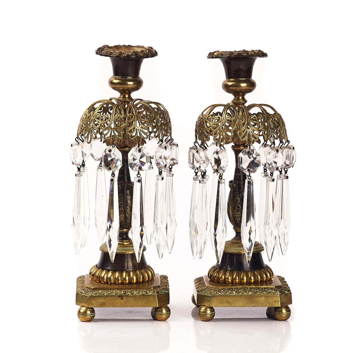 A PAIR OF REGENCY BRASS AND BRONZE PATINATED LUSTRE CANDLESTICKS (2)