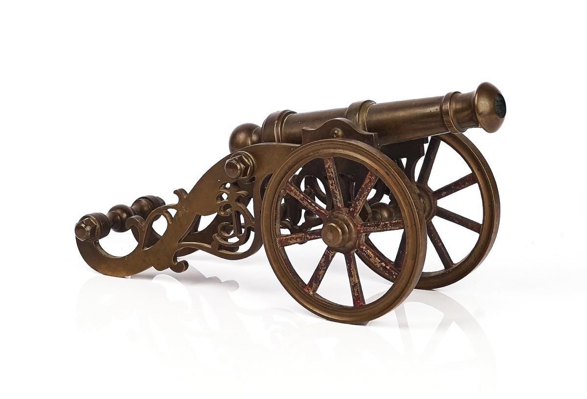 A BRASS MODEL OF A FIELD GUN