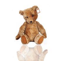 A JOINTED MOHAIR TEDDY BEAR