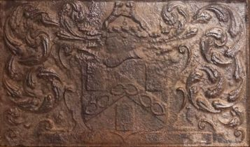 A CAST-IRON FIREBACK WITH THE ARMS OF THE WORSHIPFUL COMPANY OF IRONMONGERS