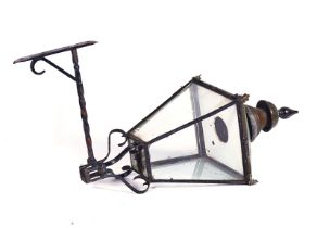 A WROUGHT-IRON AND COPPER STREET LANTERN
