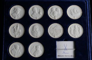 A CASED SET OF TEN MEISSEN WHITE BISCUIT COMMEMORATIVE COINS