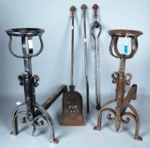 A PAIR OF STEEL ANDIRONS 44CM HIGH AND A SET OF THREE FIRE IRONS