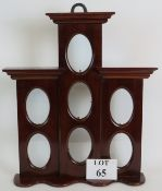 A 20th Century mahogany tiered picture f