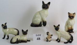Six pottery Siamese cat figurines includ