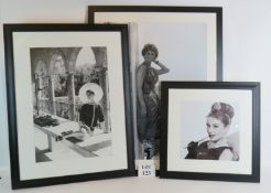 Three framed black and white photographi