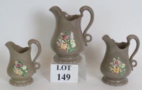 A set of three antique grey glazed Staff
