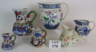 Six antique decorative jugs including th