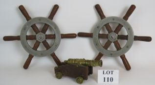 A pair of vintage ship's wheels construc