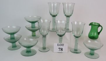 A set of six green recycled glass stemme