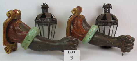 A pair of late 18th/early 19th Century carved wood Blackamoor arm wall sconces with later lanterns.