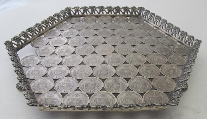 An unusual hexagonal white metal tray wi