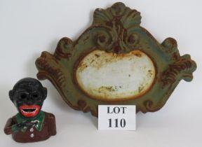 A decorative vintage cast iron cartouche